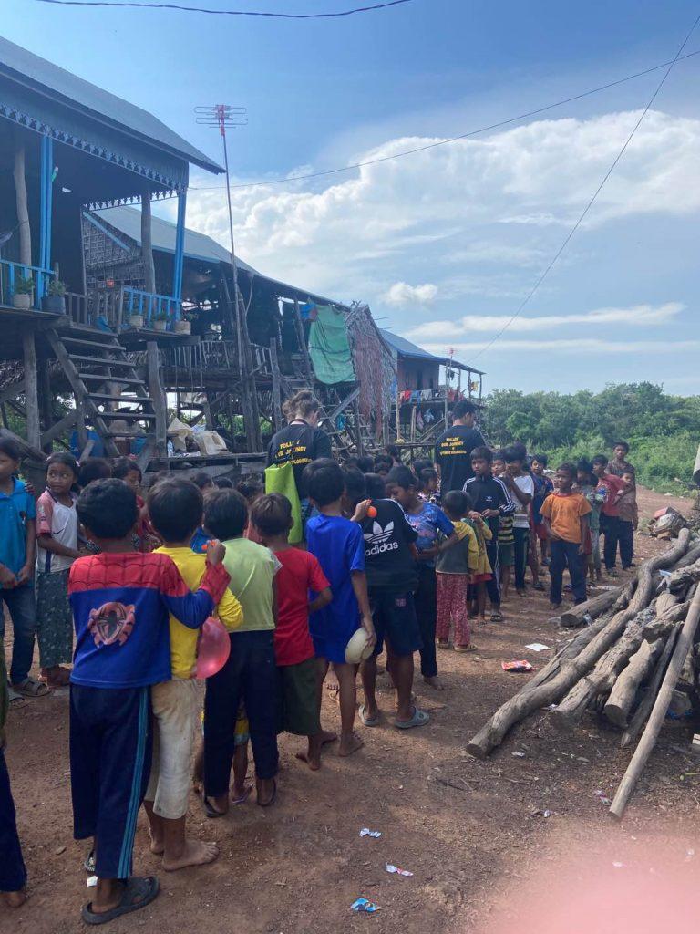 feeding kids in floating village siem reap